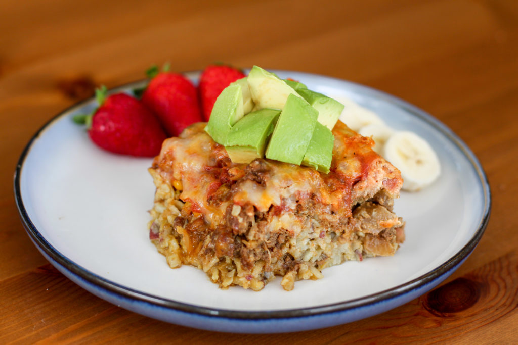 Mexican Egg Hash Casserole topped with avocado