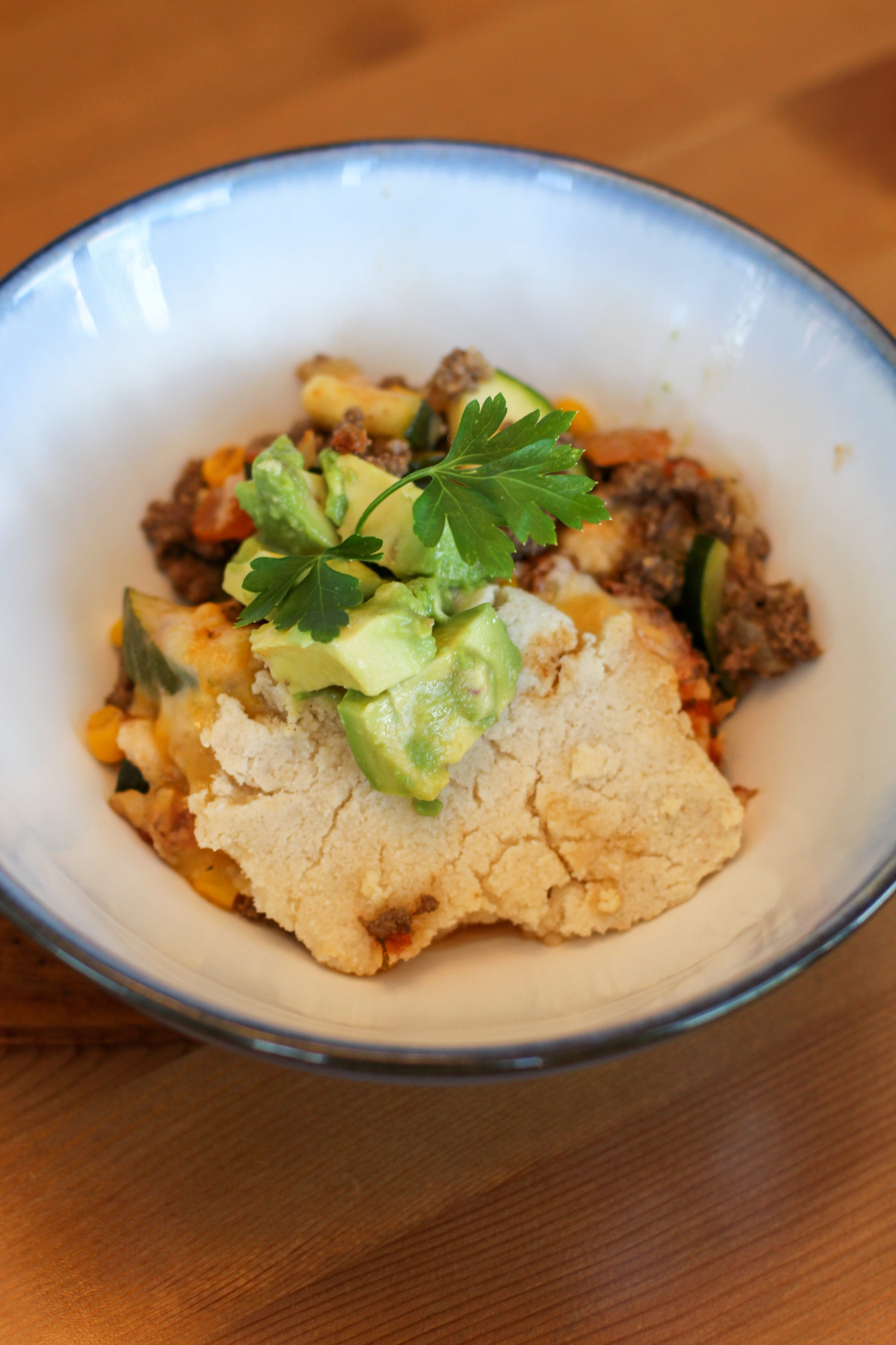 Bowl of mexican beef cobbler topped with cilantro