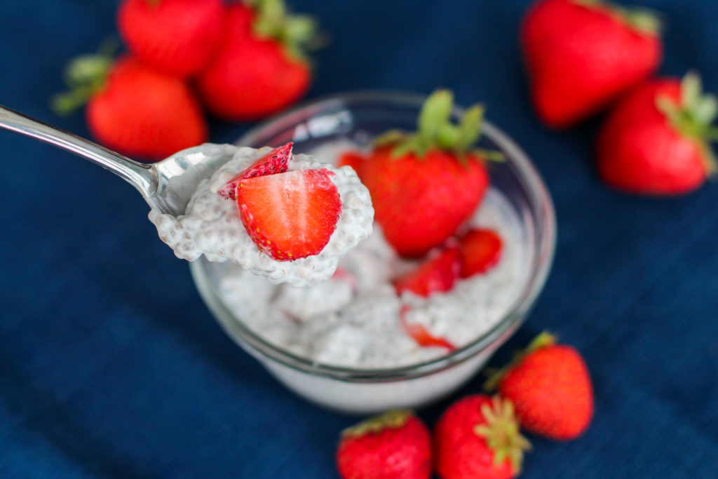 Spoon with strawberry cheesecake chia seed pudding