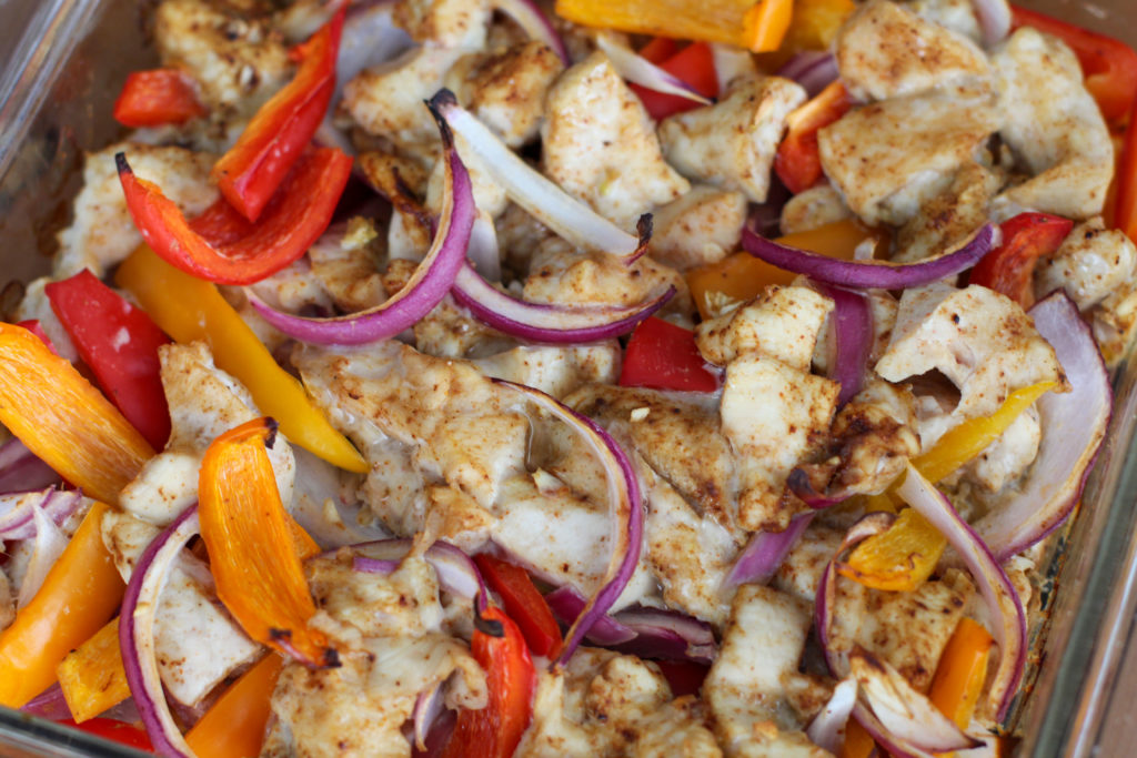 Close up dish of baked chicken fajitas