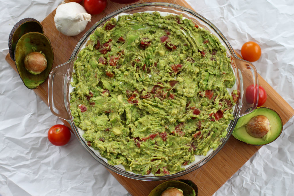 top view of homemade guacamole layer of keto 7 layer taco dip