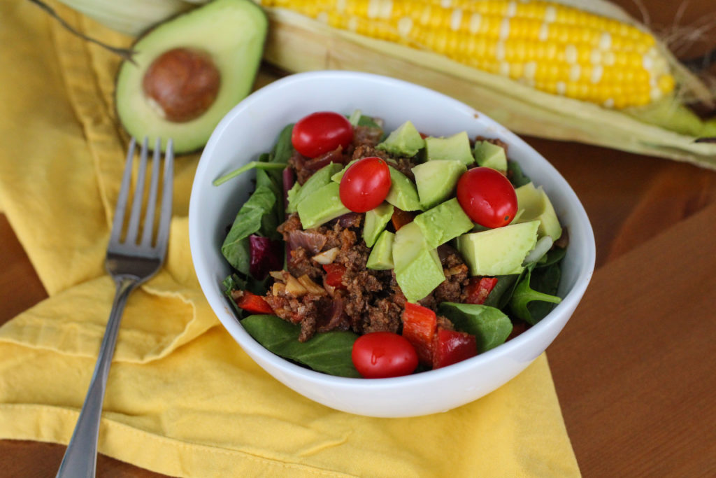 Taco Meat on salad with avocado and tomatos