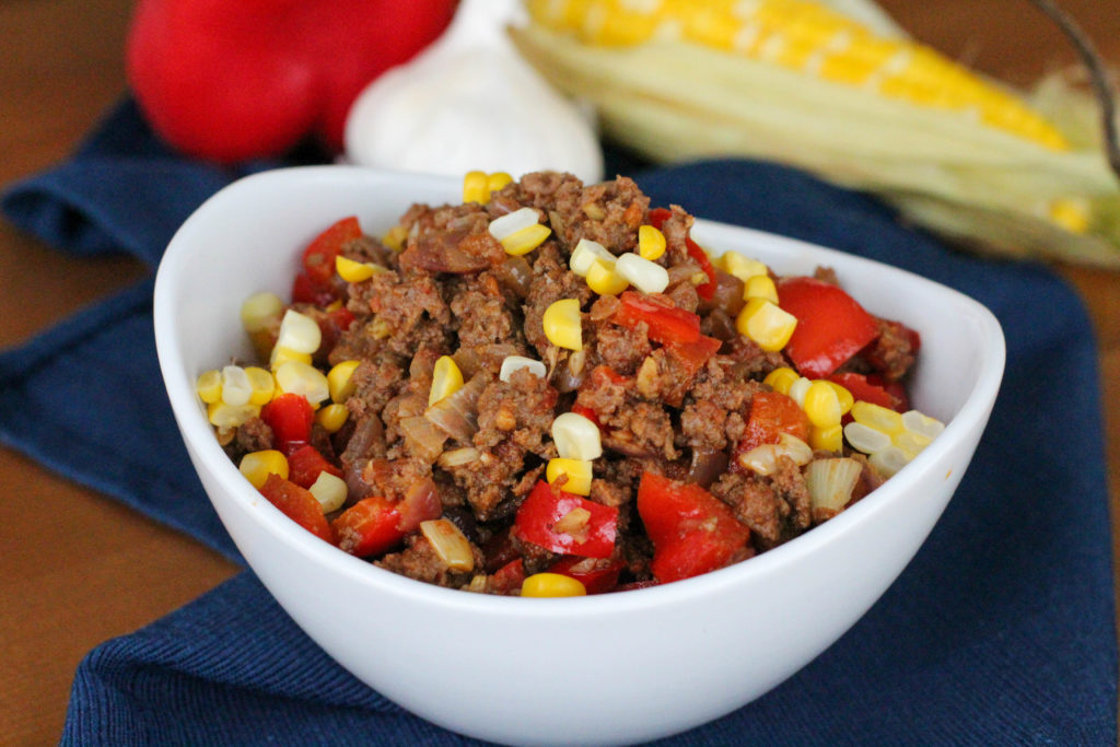 Taco meat with corn and red bell pepper