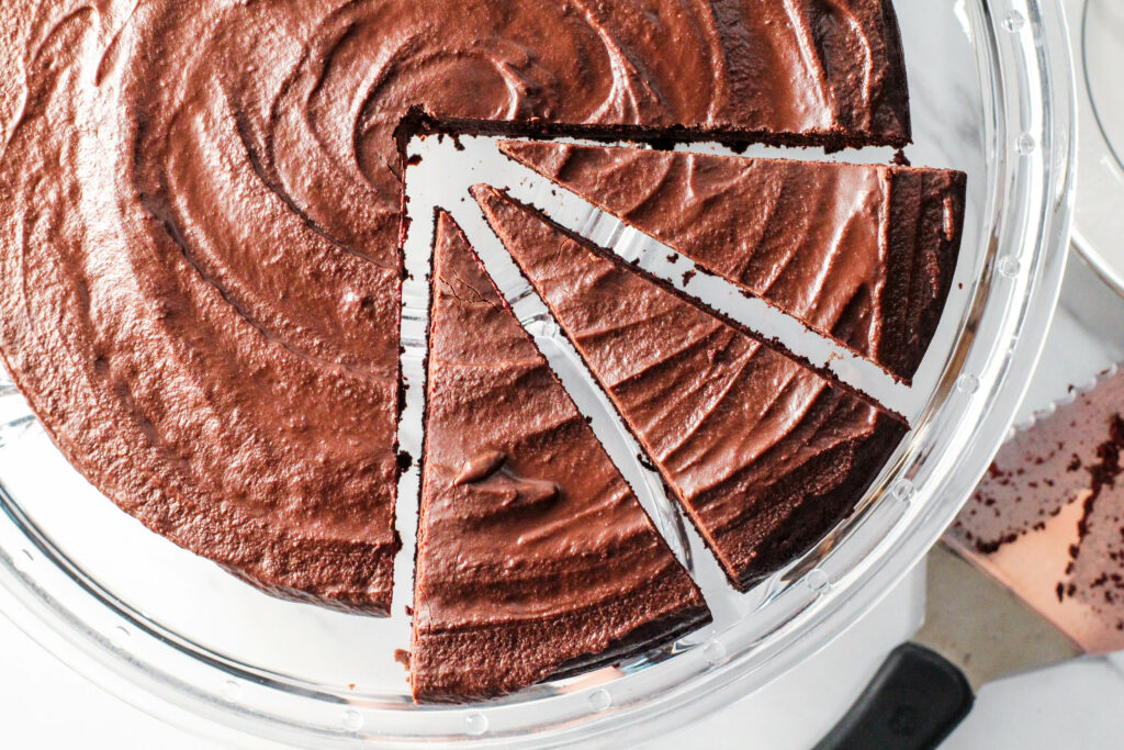 three slices of red velvet torte slightly away from main torte