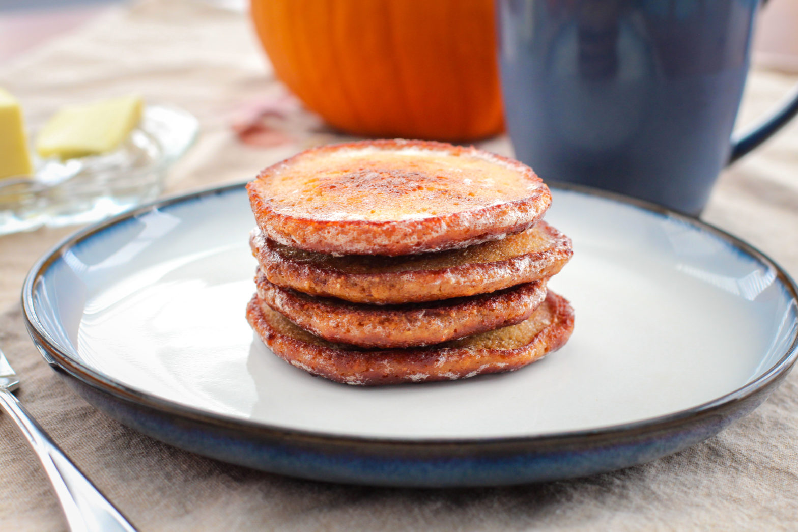 stack of pumpkin pancakes on a plate