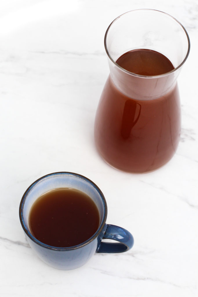 mug and pitcher of homemade vegetable broth