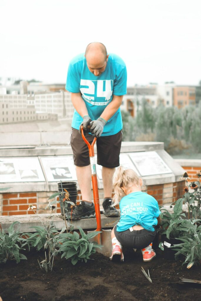 dad and little girl volunteering together as an idea for the 5 love languages