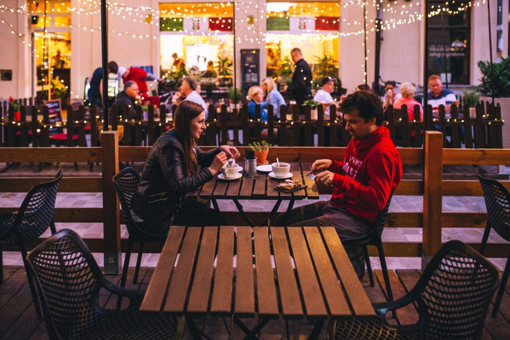 couple eating dinner at outside table