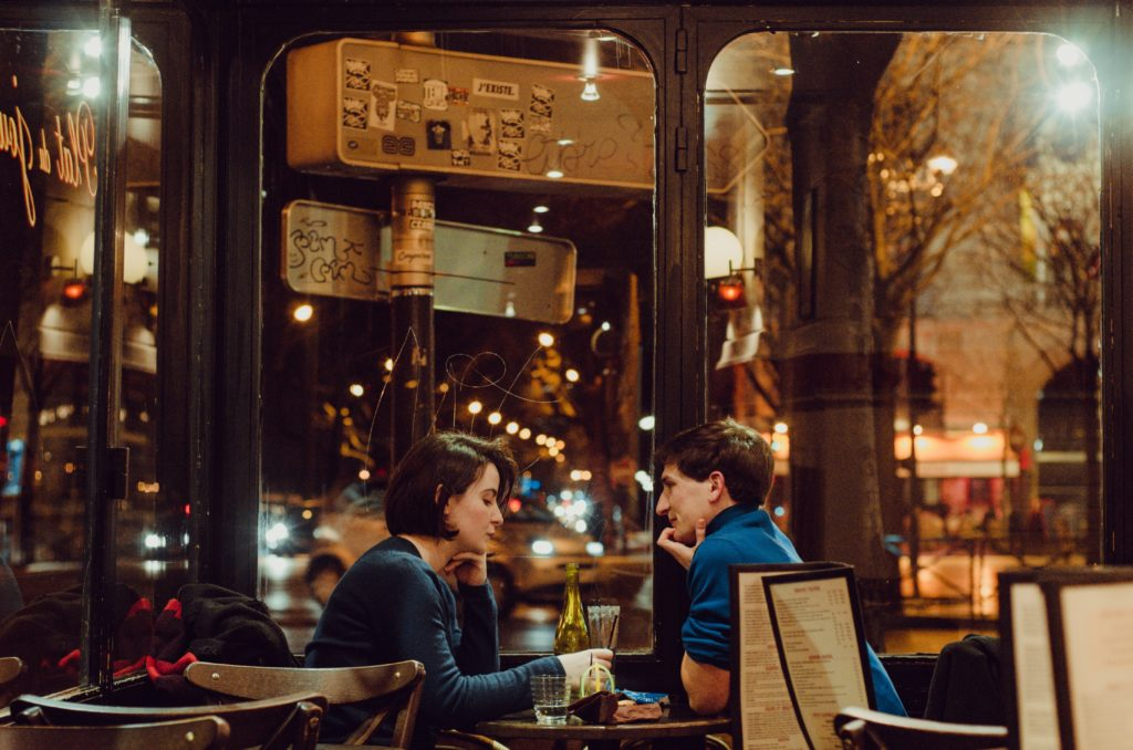 couple in coffee shop - date night conversation ideas