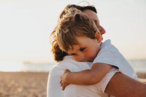 little boy hugging his mom