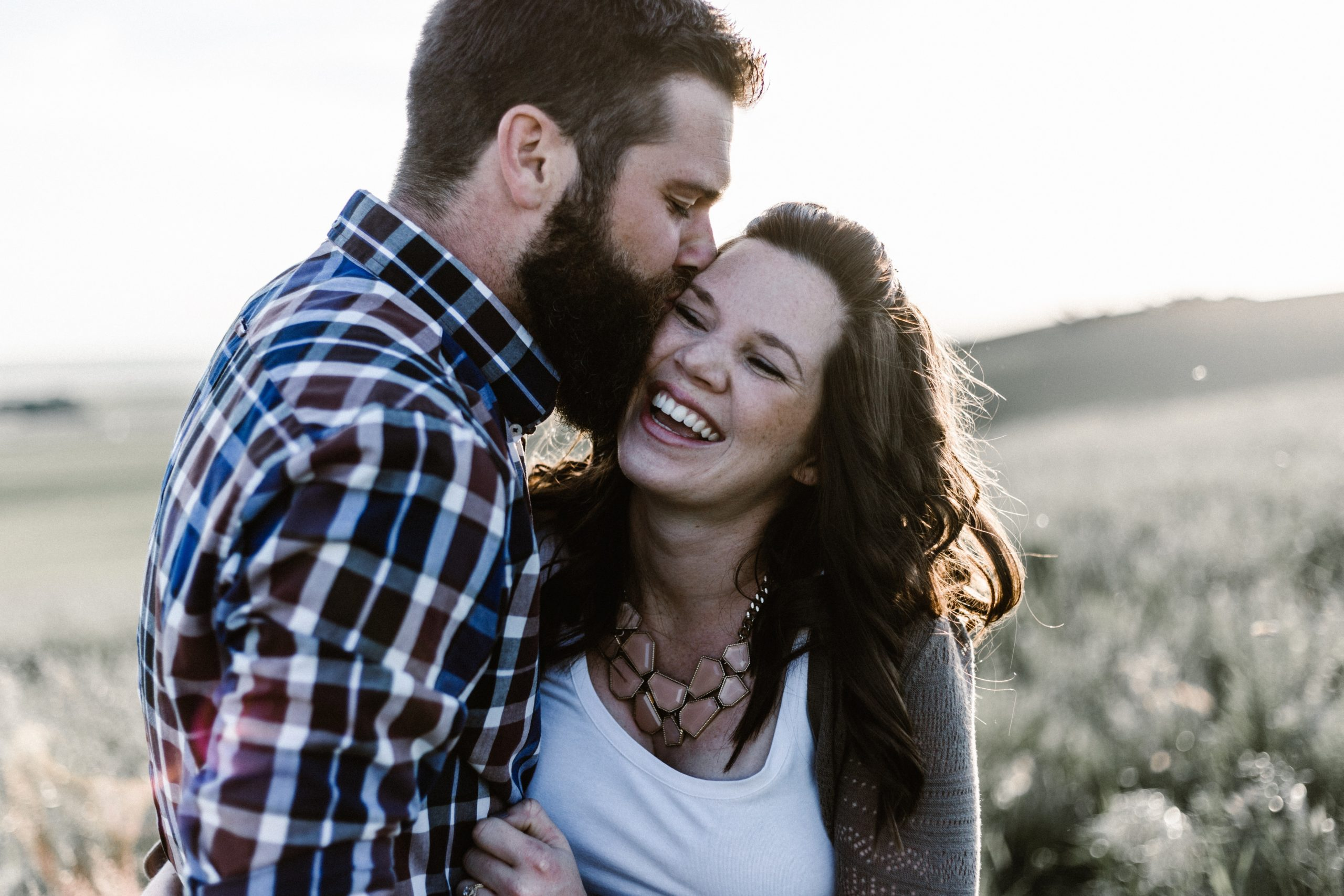 man kissing womans check