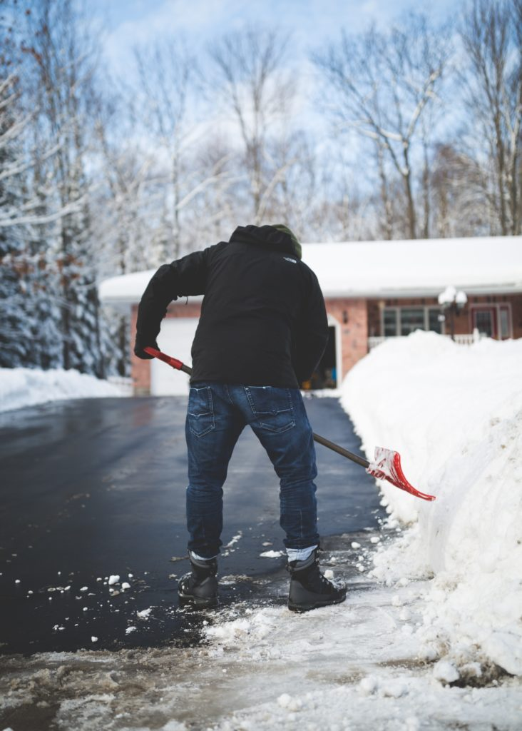 man shoveling snow on driveway - 5 love languages acts of service