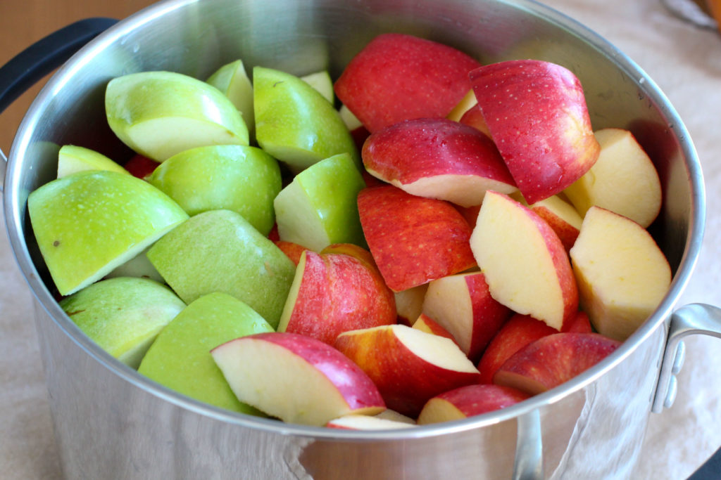 Pot of uncooked granny smith and gala apples