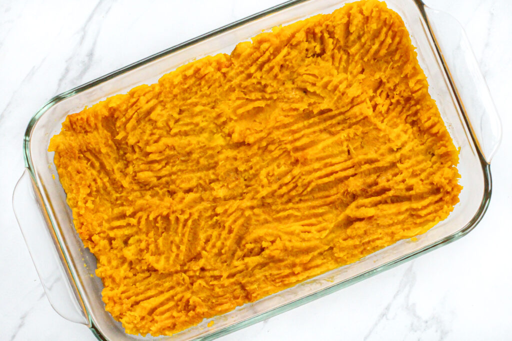 pan with buttercup squash spread in the bottom of it