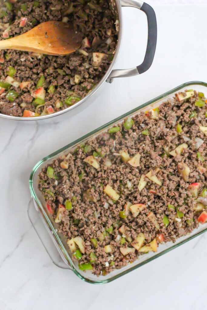 meat mixture in pan next to casserole dish