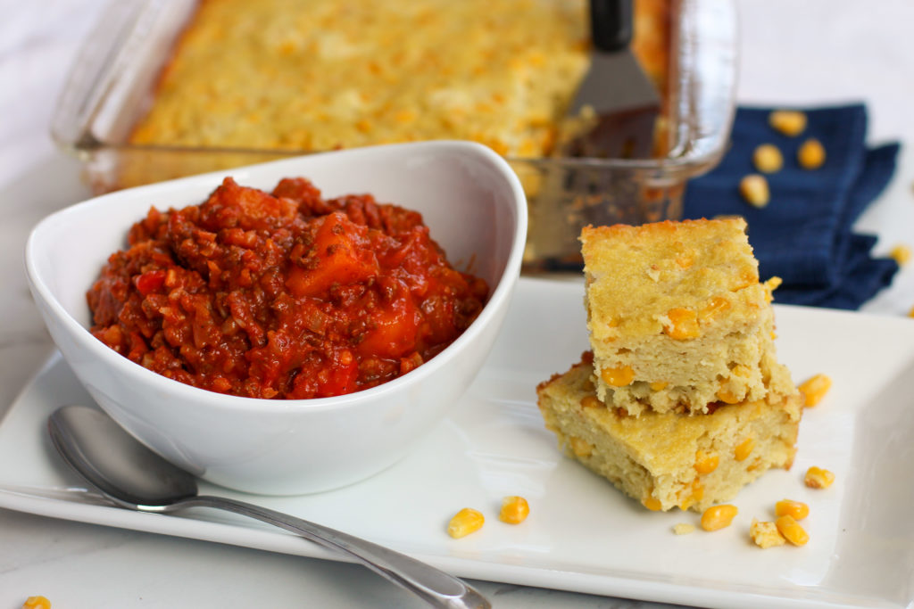 cornbread stacked next to bowl of chili