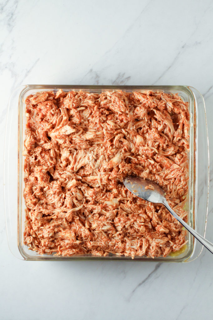 Square glass dish of BBQ shredded chicken