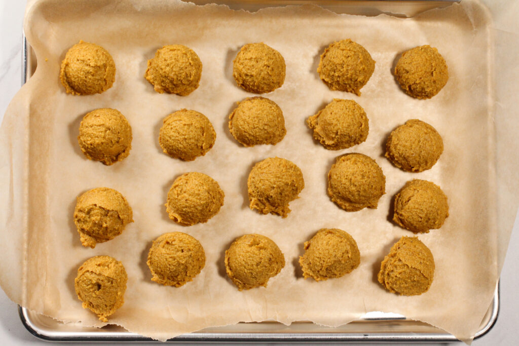 tray full of pumpkin pie truffles before being coated in chocolate sauce