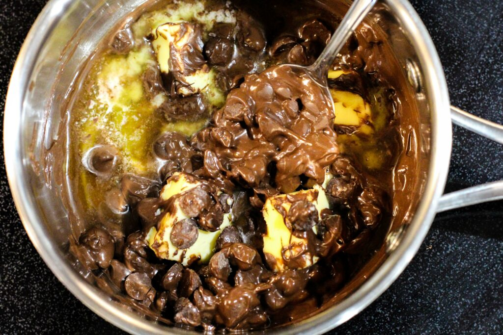Pan with chocolate sauce ingredients melting