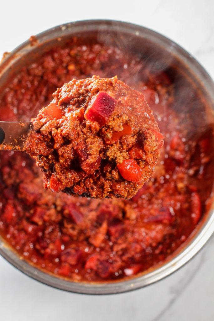 ladle holding superfood chili