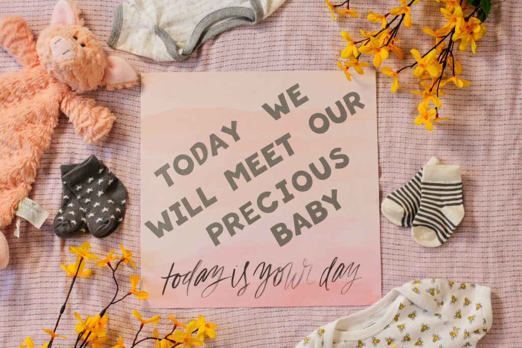 scrapbook page that says Today we will meet our precious baby for natural birth encouragement