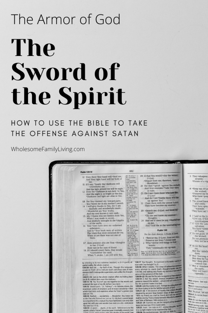 Bible lying open against white background