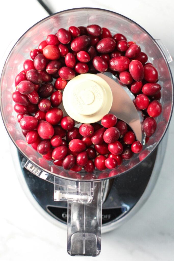food processor full of frozen cranberries