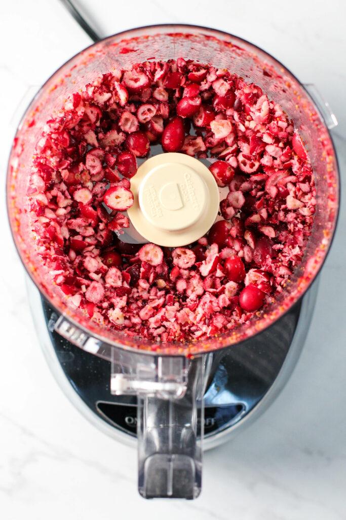 fodd processor full of chopped frozen cranberries