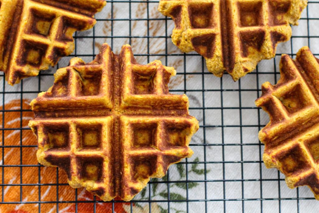 wire rack filled with pumpkin waffles