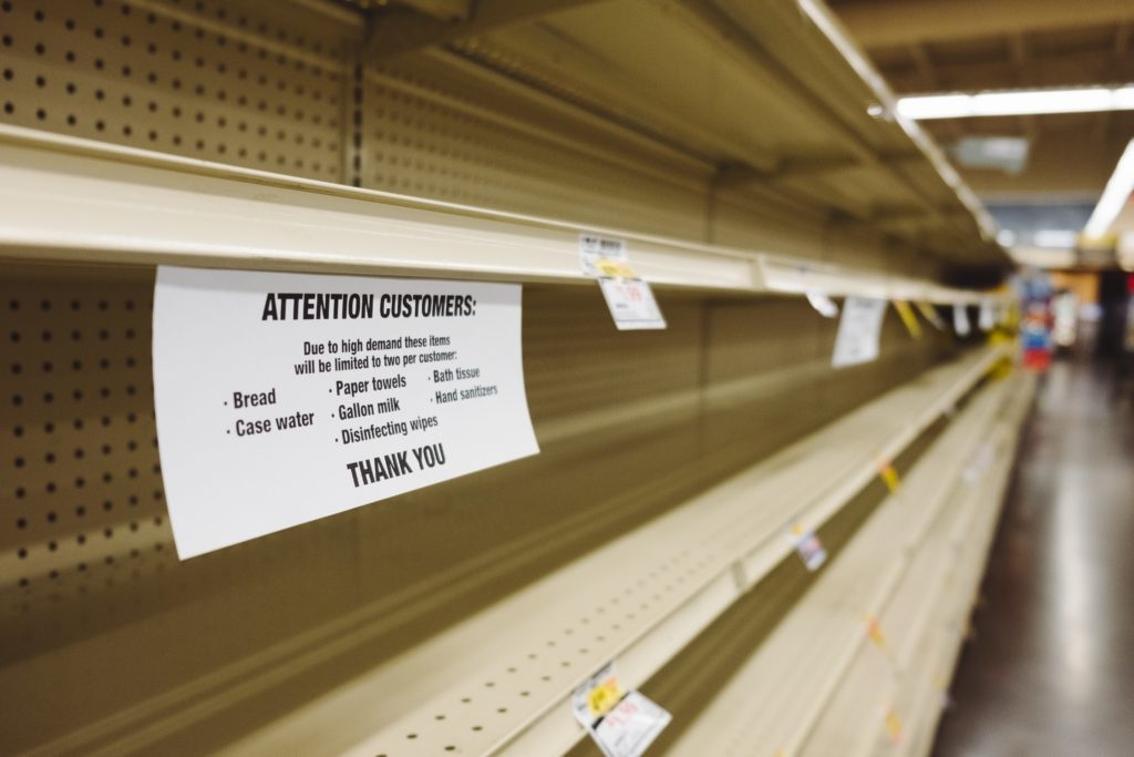 out of stock sign on grocery shelves