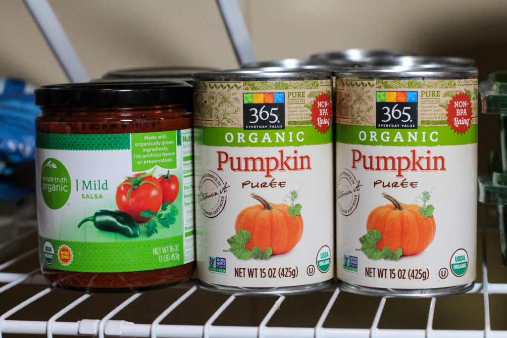 salsa and canned pumpkin on pantry shelf