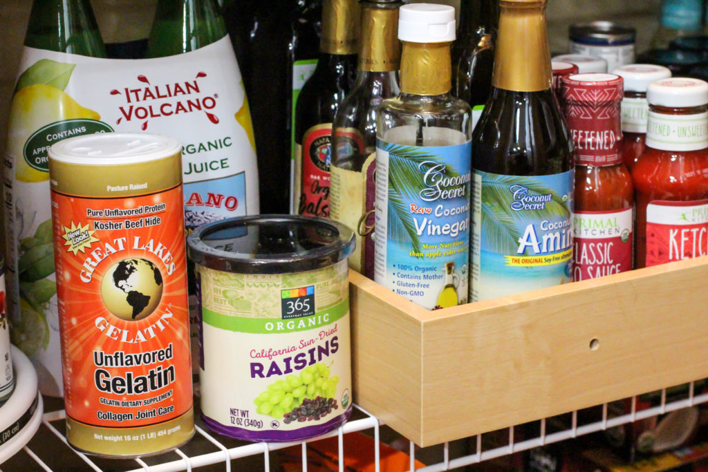 pantry shelf full of healthy shelf stable condiments