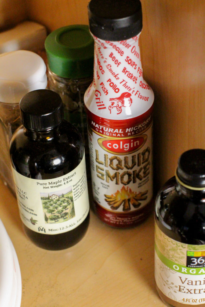 pantry shelf with liquid smoke and maple extract