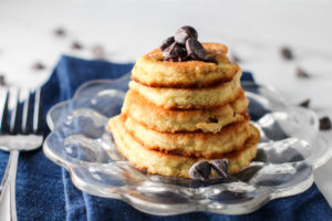 small glass plate with stack of easy chocolate chip pancakes