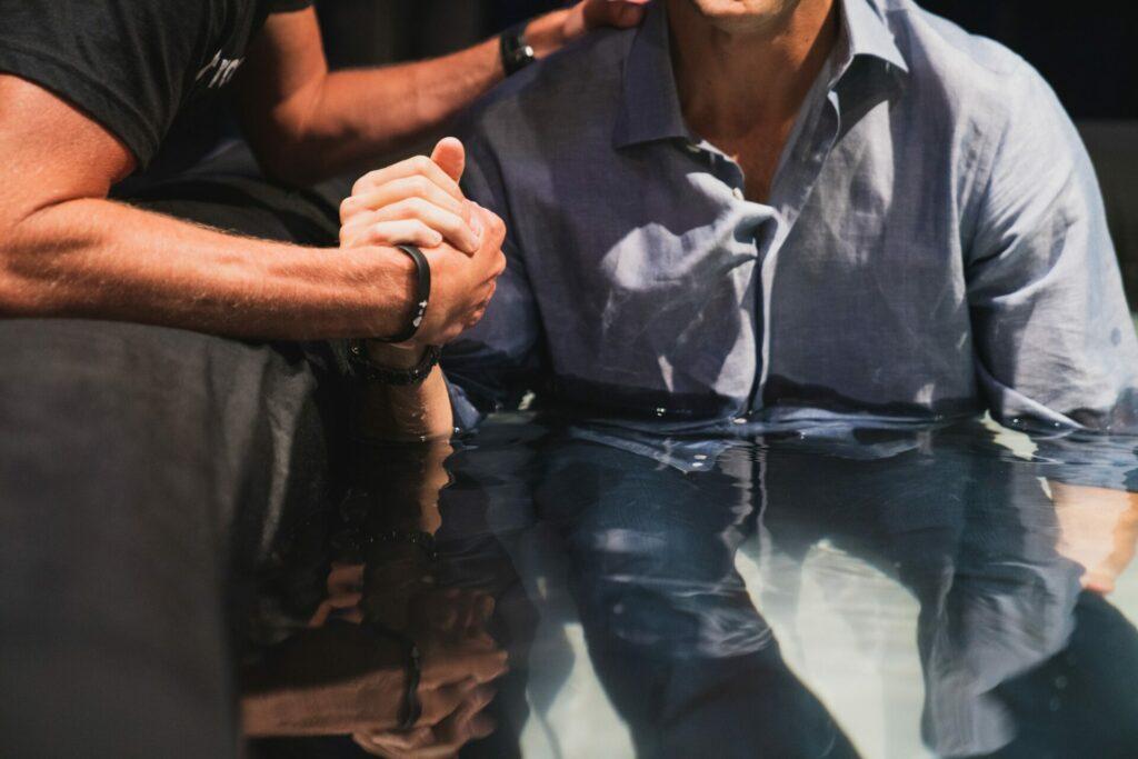 two men performing baptism