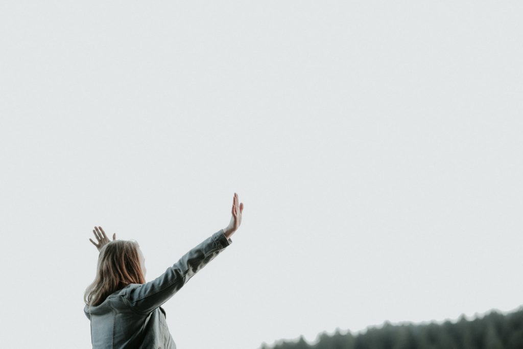woman with hands lifted in praise