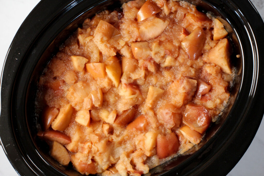 crockpot full of cooked apples