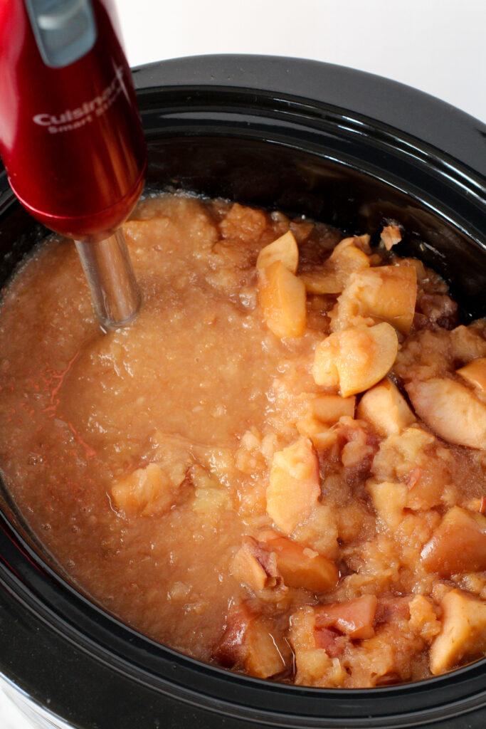 immersion blender in crockpot full of soft apples