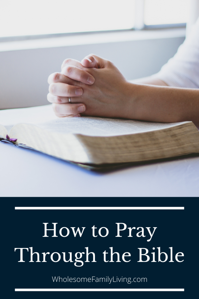 How to pray through the bible pin with hands praying on a bible