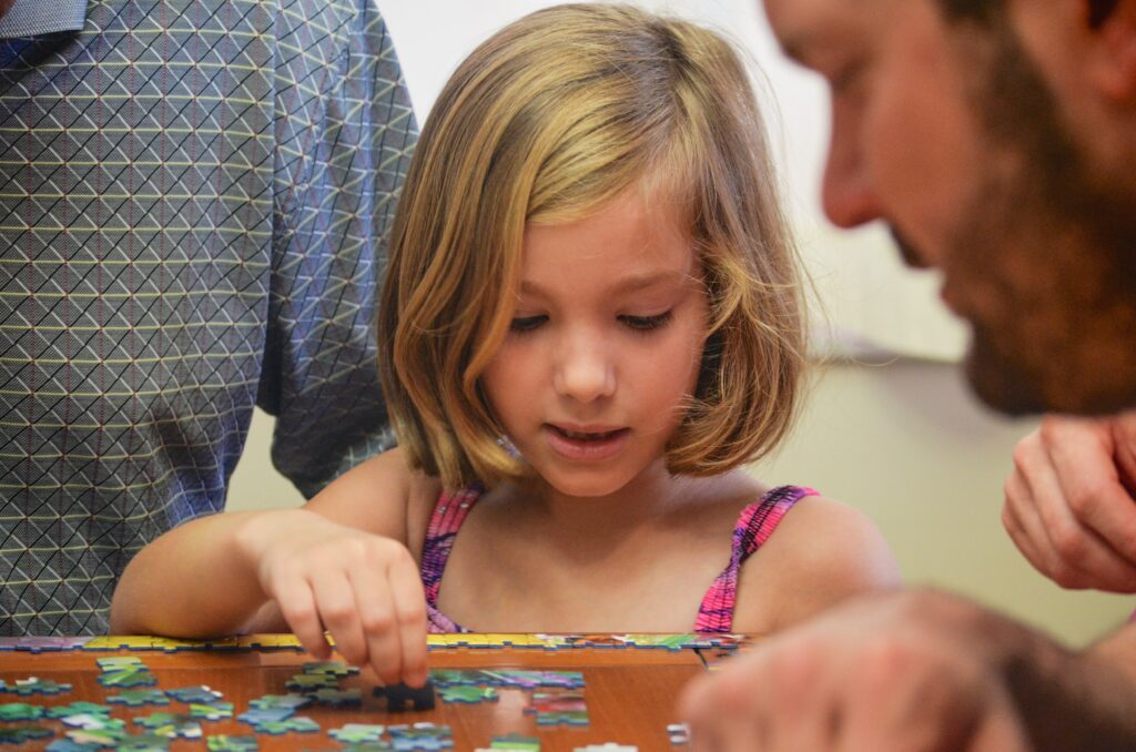Family building a puzzle together