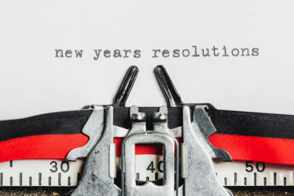 type writer with a paper that says new years resolutions