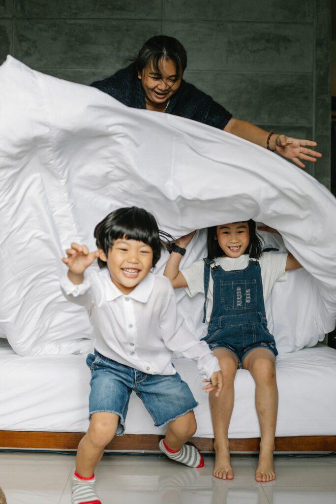 kids running under sheets