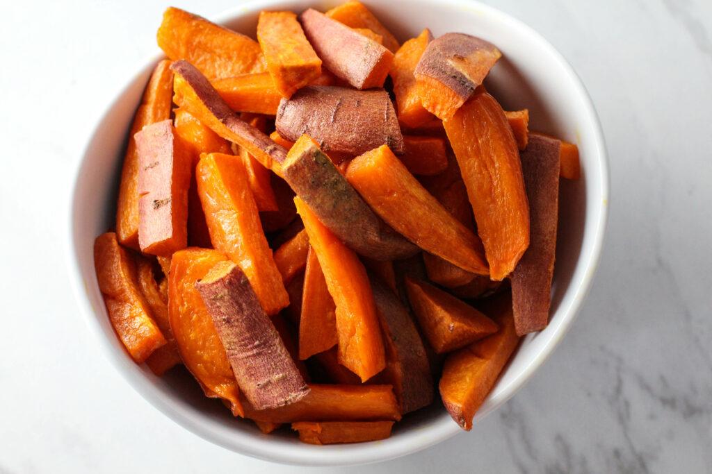 white bowl full of sweet potato fries