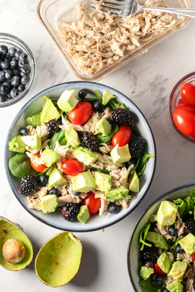 two bowls surrounded by ingredients for easy summer green salad