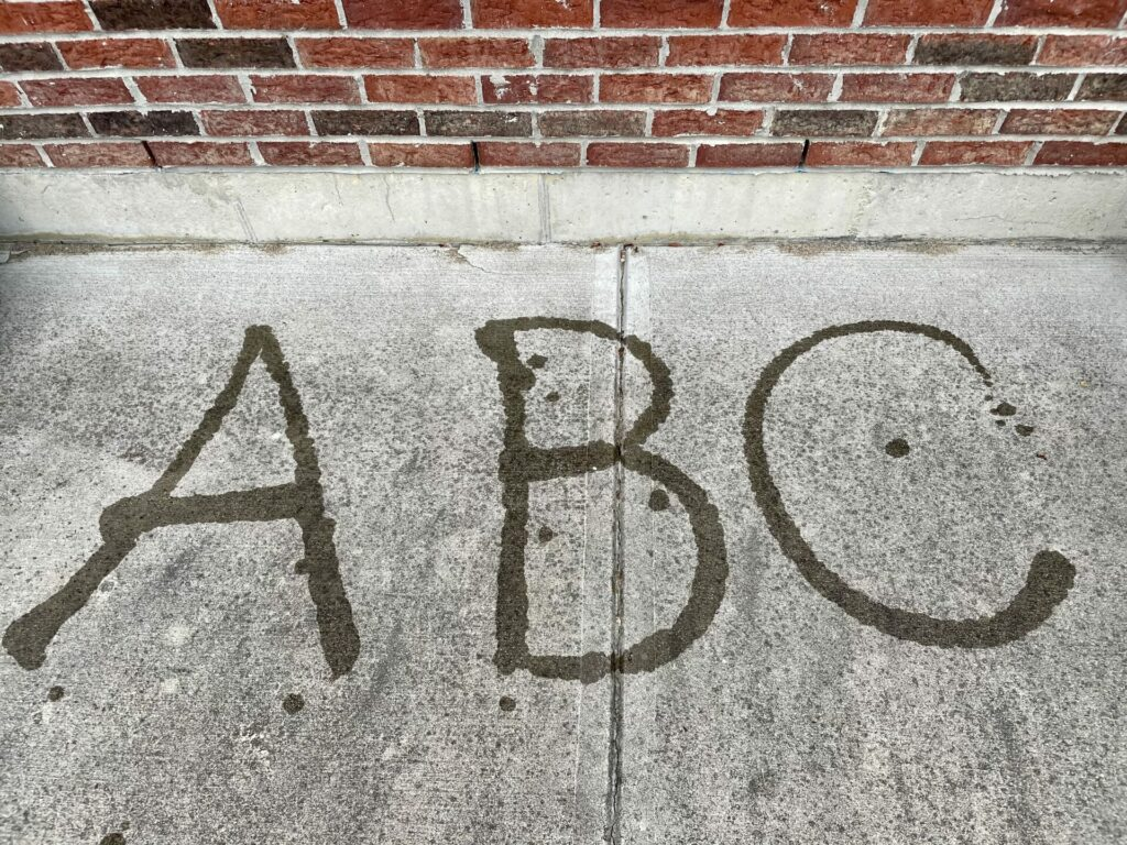 ABC spelled out in water on pavement easy backyard summer activities