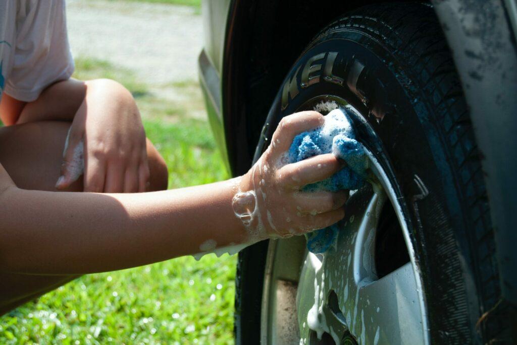 hand washing car tire