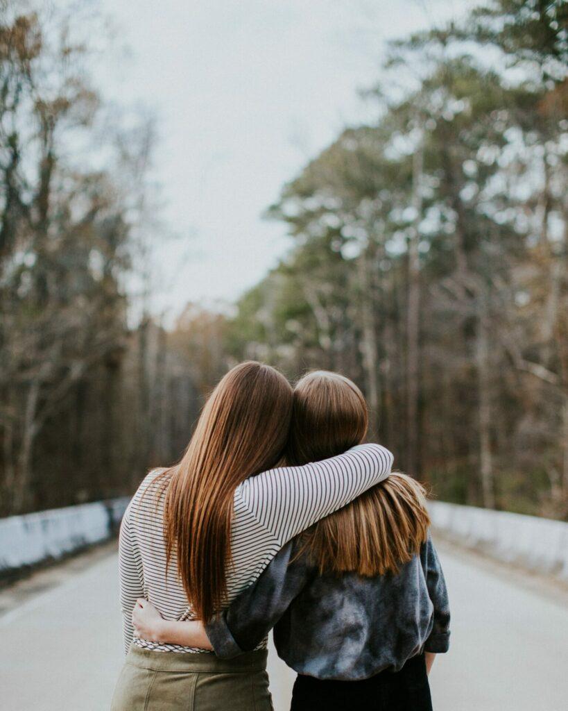 two women sharing a hug
