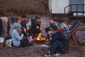 small group of people gathered around fire pit